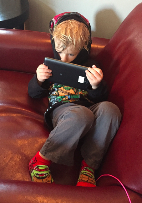 Young Gen Z boy with iPad